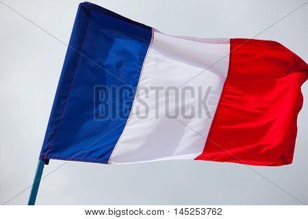 France flag waving high on the sky