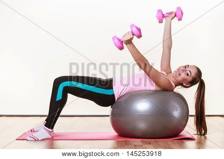 Lady Working Out With Dumbbells.