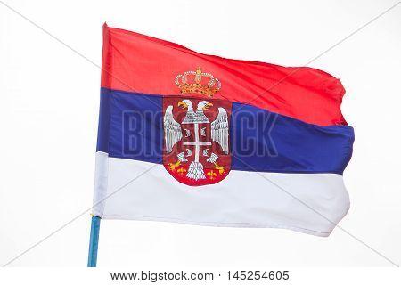 Serbian flag waving on wind high in the sky