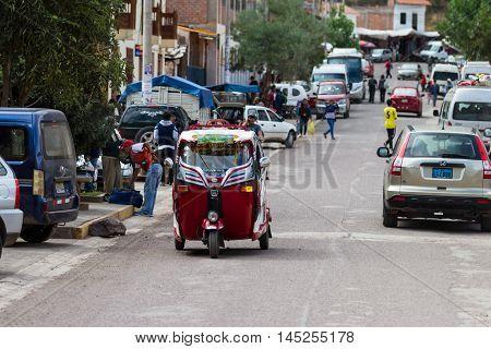 Pisac Peru - May 15: MotoTaxi a small compact vehicle making its way thru the streets of Pisac. May 15 2016 Pisac Peru.