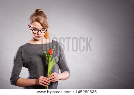 Disappointed Upset Girl With Single Tulip.