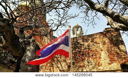 Thai ancient pagoda and buddha statue with thai flag. Thai ancient buddha and pagoda history park