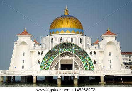 MALACCA, MALAYSIA -JANUARY 26, 2014: Malacca Straits Mosque at Malacca, Malaysia. Built on the on edge of the man-made Island called Malacca Islan