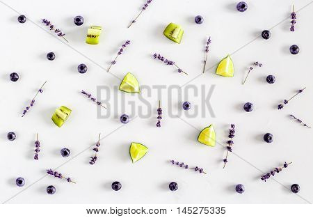 Colorful pattern made of berries with lavender on white backround top view