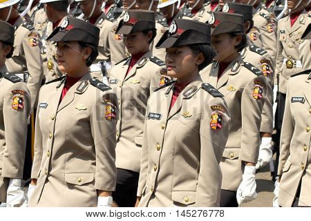 Jakarta, Indonesia - August 17, 2016: Indonesian women's police corps marching in independence day flag ceremonial at Indonesian Presidential Palace.