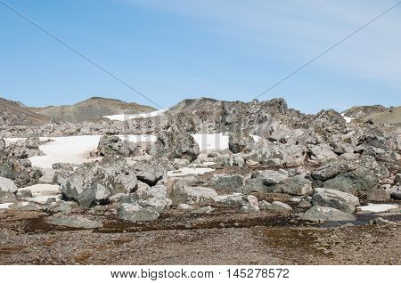 Rock mountains and snow landscape at Antarctica