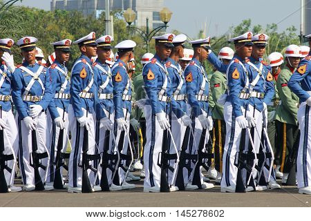 Jakarta, Indonesia - August 17, 2016: Indonesian military army cadets marching with rifle in independence day flag ceremonial at Indonesian Presidential Palace.