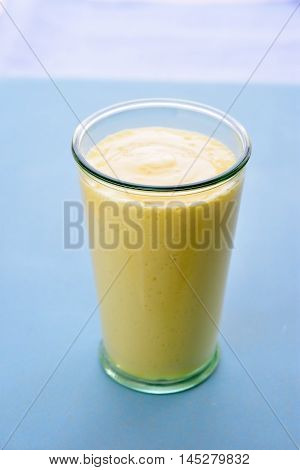 Mango lassi. Mango smoothie made with mango and yogurt yoghurt. Selective focus. Angle view.