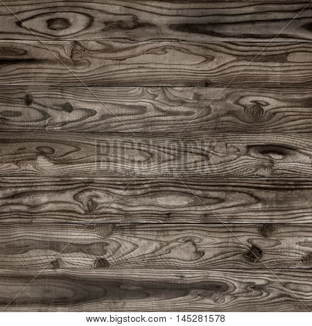 Wooden wall background or texture; Wood texture with natural wood pattern for design and decoration; Wood plank dark wood texture background
