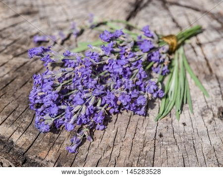 Bunch of lavandula or lavender flowers on the old wooden table.