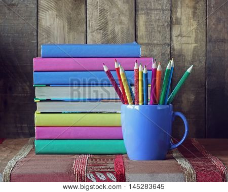 Books and colored pencils. Back to school. September 1 knowledge Day. The teacher's day.