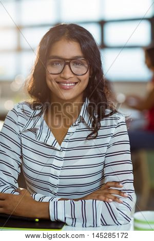 Portrait of smiling businesswoman in spectacles at office