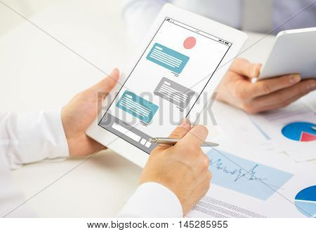 business, people, technology, online communication and teamwork concept - close up of businessman hands with messenger on tablet pc computer screen at office