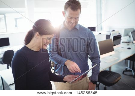 Mature students using digital tablet in the computer room at college