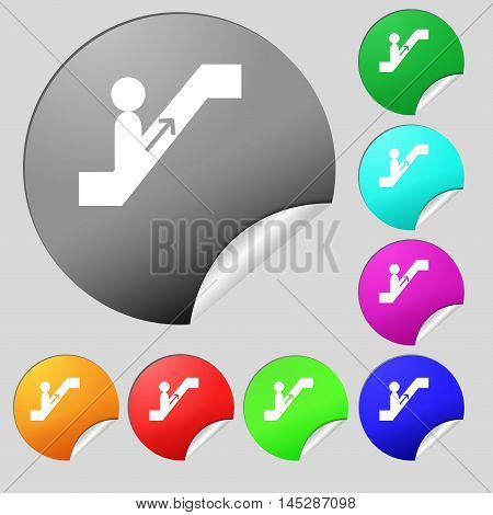 Escalator Icon Sign. Set Of Eight Multi Colored Round Buttons, Stickers. Vector