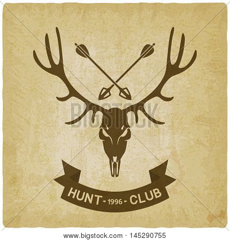 deer skull silhouette on crossed hunting arrows old background. hunting club design. vector illustration - eps 10