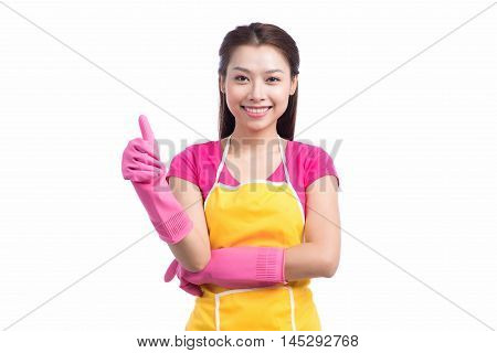 Smiling young cleaning asian lady with pink rubber gloves showing ok sign with thumbs up over white