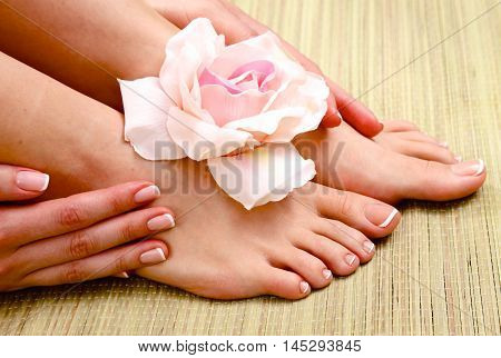 Beautiful feet with perfect spa french nail pedicure .