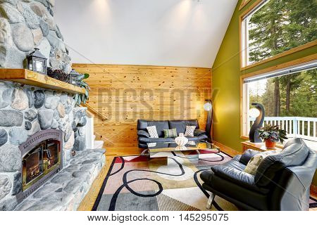 Family Room Interior With Stone Wall And Wooden Wall Paneling