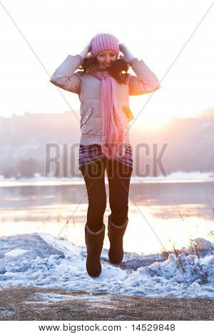 Positive Smiling Girl In Winter Clothes - Jumping