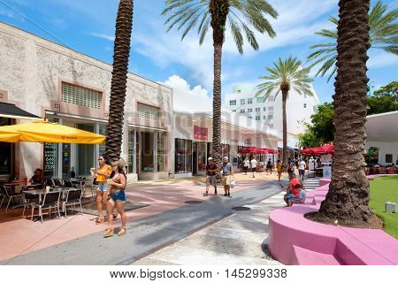 MIAMI BEACH, USA - AUGUST 27, 2016 : People, shops and restaurants at Lincoln Road, a famous tourist destination and shopping mall in Miami Beach