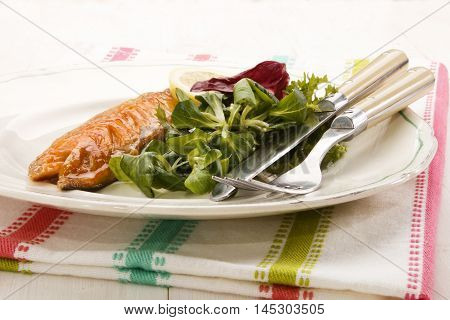 smoked mackerel with fresh salad on a plate