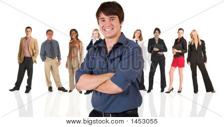 Young Businessman Standing In Front Of A Business People Group