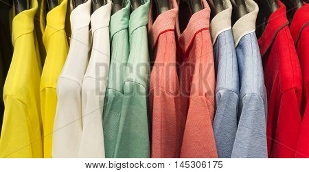 retail - clothes rail with colorful shirts
