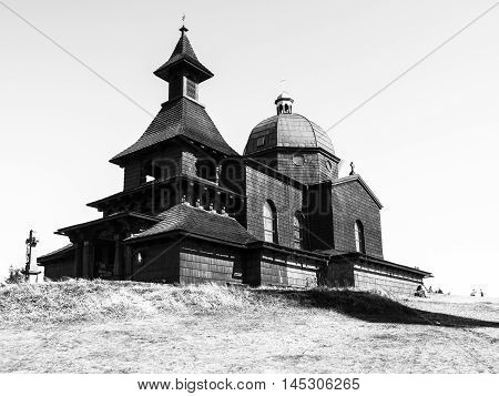 Wooden Chapel of St. Cyril and St. Methodius on the top of Radhost Mountain in Beskids, aka Beskydy Mountains, Moravia, Czech Republic . Black and white image.