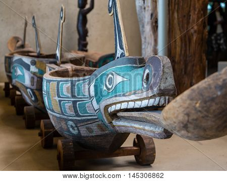 Hollowed out Inuit canoe with colorful paintings