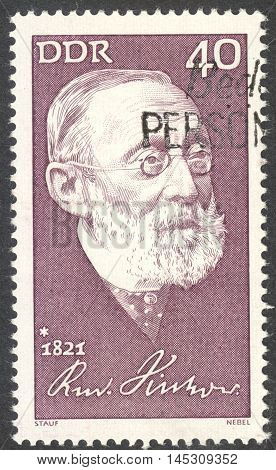MOSCOW RUSSIA - CIRCA AUGUST 2016: a stamp printed in DDR shows a portrait of Rudolf Virchow the series