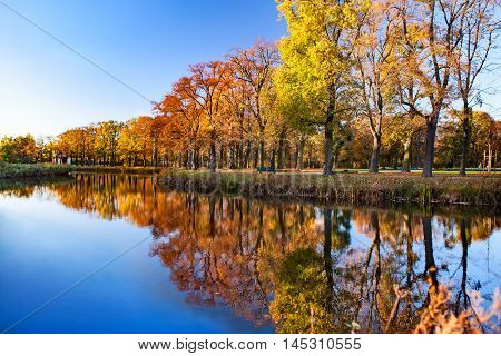 View on autumn landscape of river and trees. Herrenhausen Gardens, Hannover
