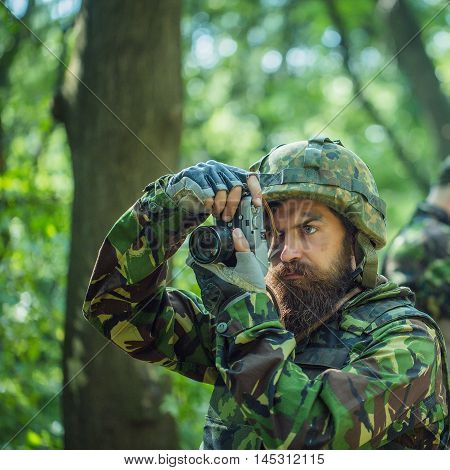 Soldier With Camera In Forest