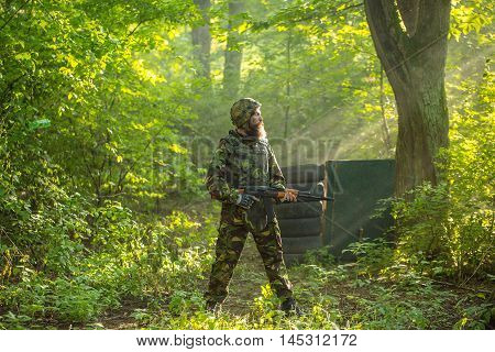 Soldier With Rifle In Forest