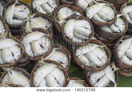 Thai gulf mackerel fish steamed on bamboo basket thai market ; Thai people called this fish is Pla-too