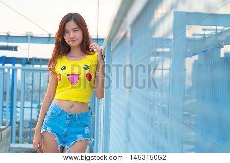Bangkok, Thailand – August 24,2016:  Trainer  Girl   Playing Pokemon , Pokemon Ball , Wear Shirt Pik