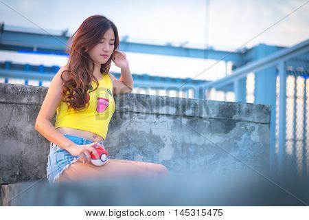 Bangkok, Thailand – August 24,2016:  Trainer  Girl   Playing Pokemon , Pokemon Ball