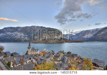 Beautiful village of Hallstatt on the side of a lake in the Alps in Austria