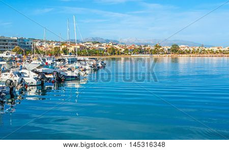 The Aegean coast of Rethymno resort with the yachts and motor boats in the new port Crete Greece.