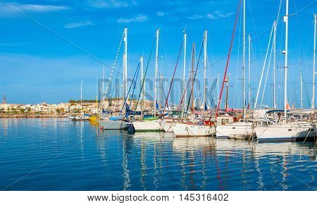 The white sailing yachts in the new port wait for the trips Rethymno Crete Greece.