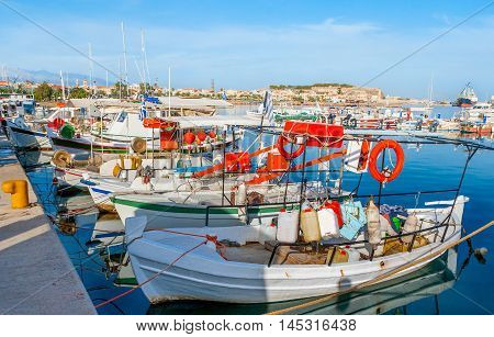 The fishing boats occupy many piers in the new port of Rethymno Crete Greece.