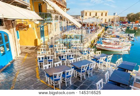 RETHYMNO GREECE - OCTOBER 16 2013: The old harbor can be named the gourmets' street the local outdoor restaurants are the best in old town on October 16 in Rethymno.