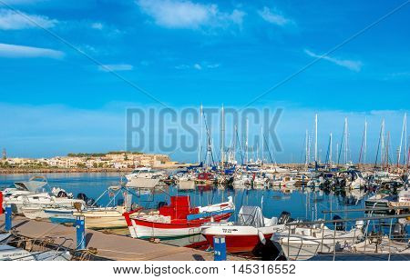 RETHYMNO GREECE - OCTOBER 16 2013: The new port is located aside of the old town and contains a lot of yachts and boats on October 16 in Rethymno.