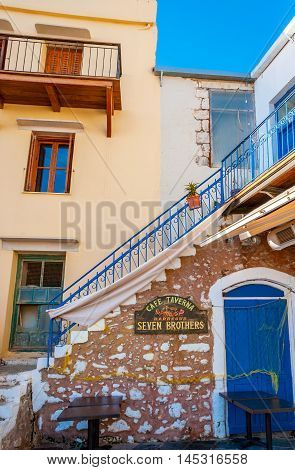RETHYMNO GREECE - OCTOBER 16 2013: The wall and the staircase of the old house located in port and serving as the tourist restaurant on October 16 in Rethymno.
