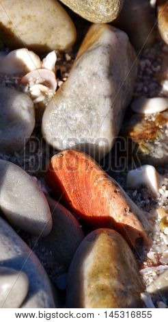 Close up of iron red stone on the beach