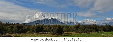 Landscape with the Hottentots Holland Mountains and withe clouds in the sky