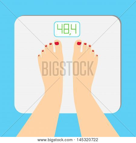 The young woman is weighed on scales. female feet with a pedicure are on an electronic balance