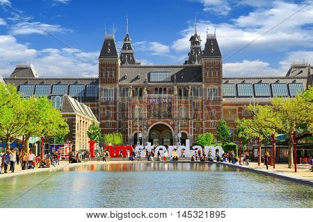 Amsterdam, Netherlands - May 13, 2016: Rijksmuseum museum on May 13, 2016 in Amsterdam. Words I Amsterdam in front of the Rijksmuseum is a  popular touristic destination in Amsterdam