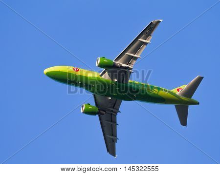 Moscow region - July 31 2016: Bright green passenger aircraft Airbus A319-114 S7 Airlines flies to Domodedovo airport July 31 2016 Moscow Region Russia
