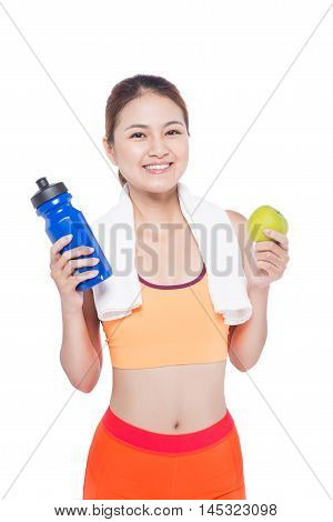 Portrait of young attractive asian woman with green apple and bottle. Dieting concept. Isolated on white.
